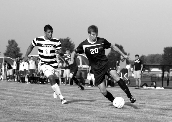 Jeff McLaughiln '14 dribbles the ball to the goal against Bryant on Tuesday night.