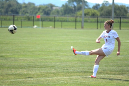 Anna Wissler '15 passes to a teammate during Sunday's game against Sacred Heart.
