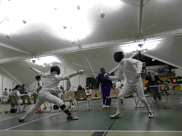 [Photo courtesy of Dave Jennings] David Jennings '16 (left) scores a touch.