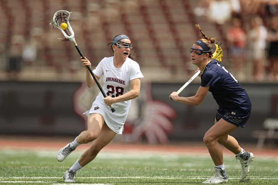 Junior+attacker+Emma+Novick+charges+toward+her+opponent.+Photo+Courtesy+of+Athletic+Communications