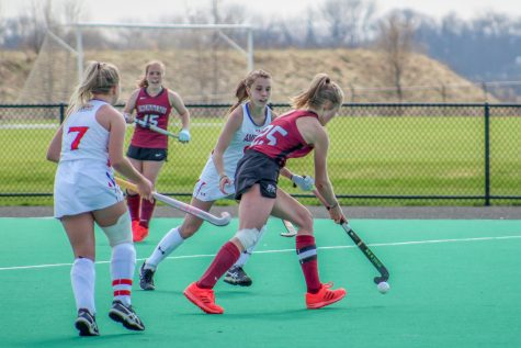 Senior midfielder Anna Steps fends off two American players last weekend. (Photo courtesy of Athletic Communications)