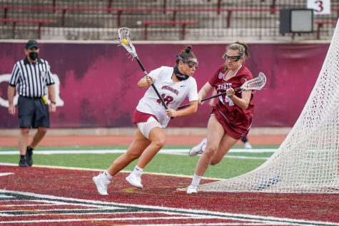 Junior attacker Olivia Cunningham (left) turns on the jets against a Colgate defender. (Photo courtesy of Athletic Communications)