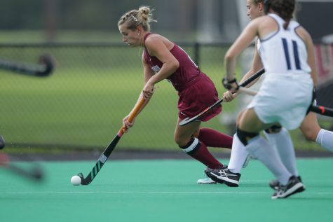 Womens field hockey player in action during the 2021-2022 season. (Photo courtesy of Athletic Communications)
