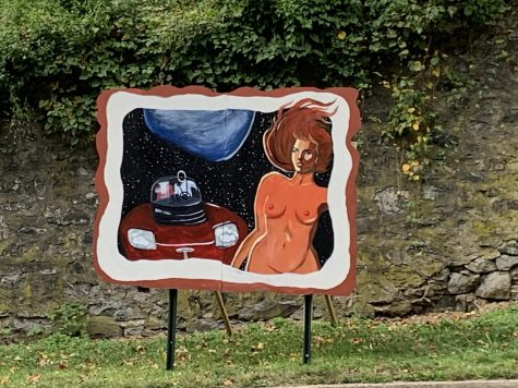 The portion of Anastasiia Shakhurinas 22 mural depicting a Tesla car in space was put up the Friday before Family Weekend, but the uncensored version of the right side was put up Tuesday. (Photo courtesy of Anastasia Shakhurina 22)