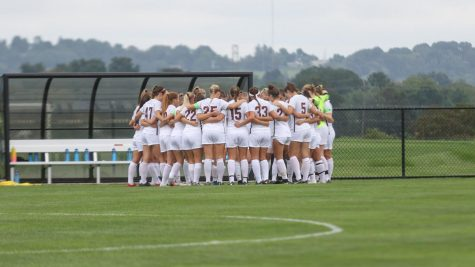 The team regroups after a matchup against Long Island University is postponed. (Photo courtesy of Athletic Communications)