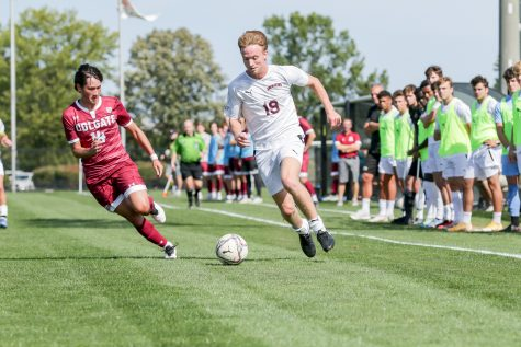 Sophomore Carter Houlihan handles the ball as the Leopards dominate in the battle against Colgate, holding them to just two shots on goal. (Photo courtesy of Athletic Communications)