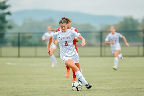 Junior forward Melissa Lamanna scores her fourth goal of the season during Saturdays back-and-forth affair against American. (Photo courtesy of Athletic Communications)